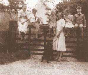 photograph taken by Ivan March showing (from left to right) his wife Joan, their son Hugh, daughter Heather, his sister Molly Breeze, another daughter Diana and Molly's son Michael.  In front is the dog Rex.